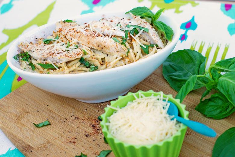 A pasta alfredo recipe using cajun blackened chicken breasts and a fresh alfredo pasta over noodles.