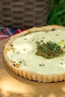 caramelised onion tart topped with goats cheese and pesto. Served at a picnic
