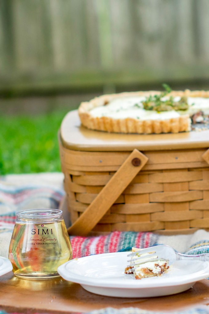 Caramelised onions peek through the bottom of a tart, perfect for an alfresco lunch