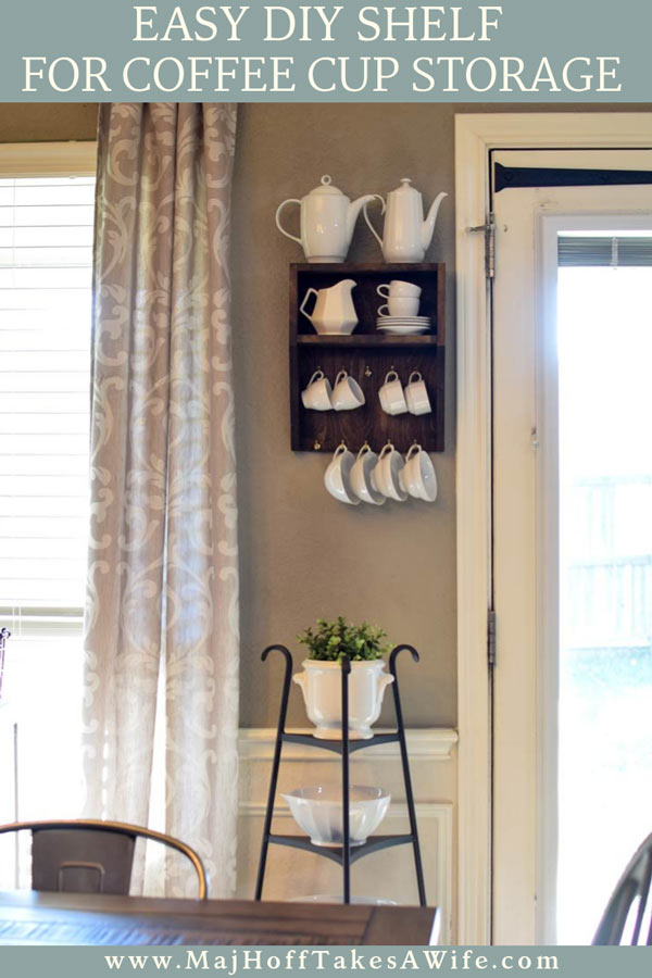 This easy DIY mug holder is so easy to make! Stain or paint an unfinished premade wooden wall shelf any color you'd like and add hooks for easy cup storage! Free up cabinet and countertop space. Match any decor and give your coffee cups a home! via @mrsmajorhoff