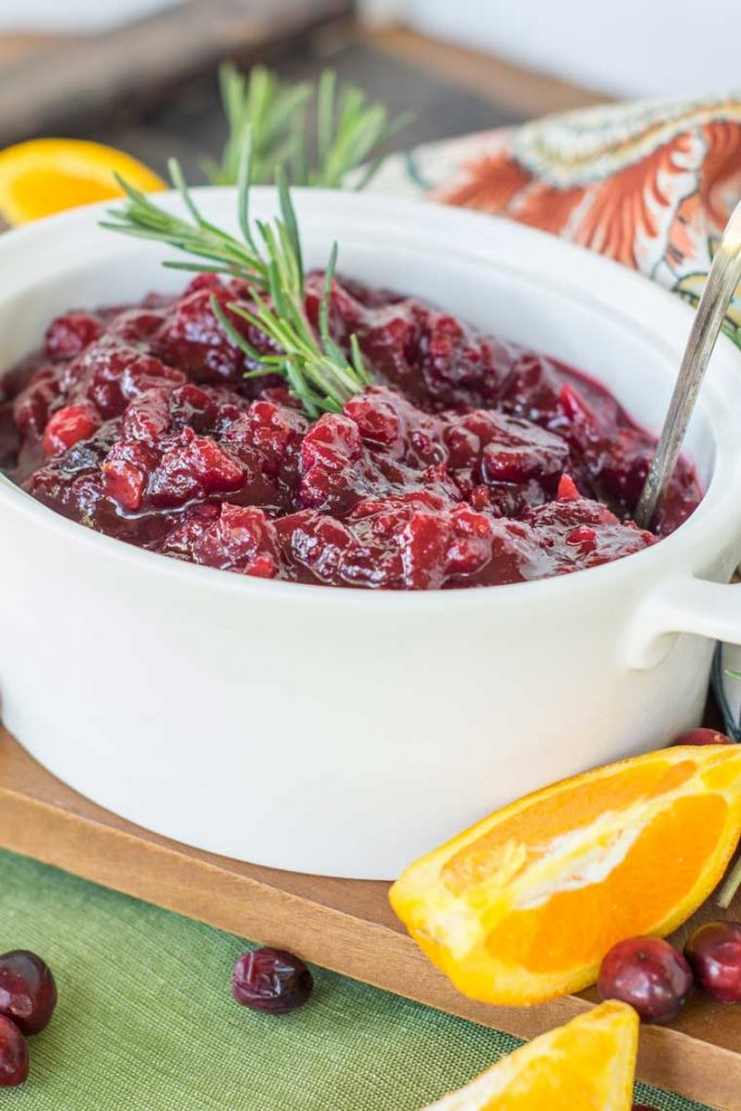 This EFFORTLESS homemade Make Ahead Cranberry Sauce will WOW your guests! The BEST Cranberry Sauce Recipe! You'll never buy canned sauce again!