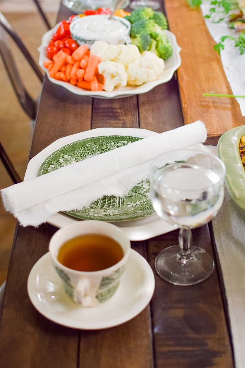 green and white ironstone dishes on a Thanksgiving table