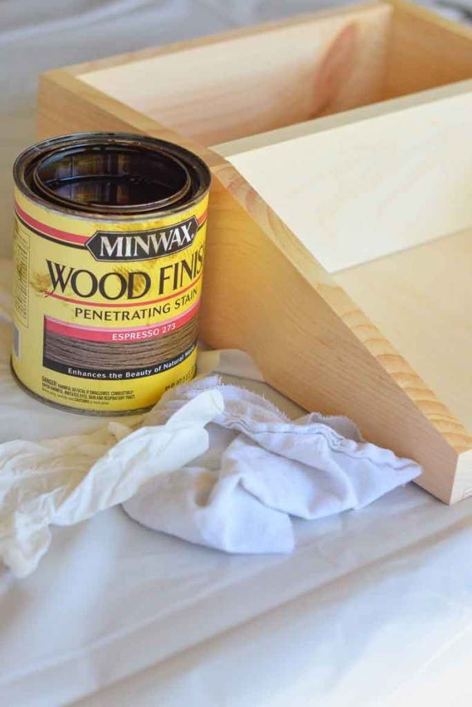 Using minwax to stain a pine shelf with old t-shirts and a plastic disposable glove