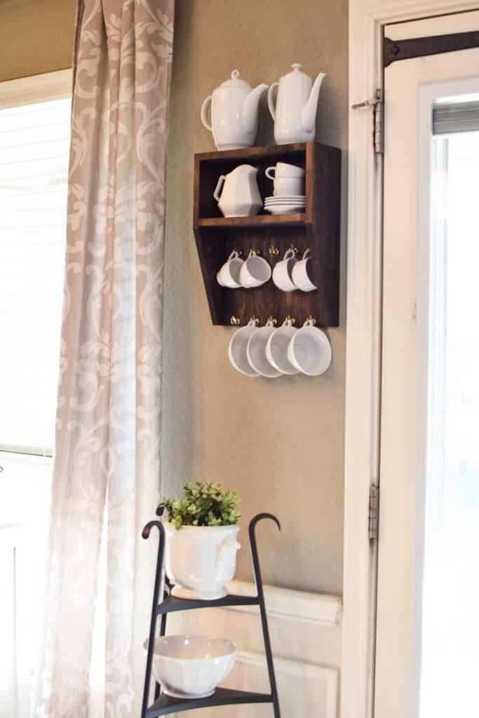 Easy DIY mug holder hanging on a wall to hold coffee and tea mugs and cups