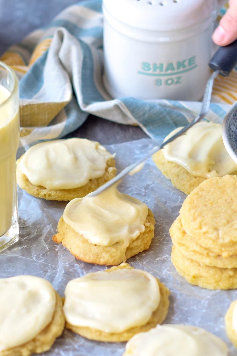 Use an small off set spatula to frost eggnog cookies with eggnog icing