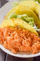 a plate full of mexican rice that is made from scratch