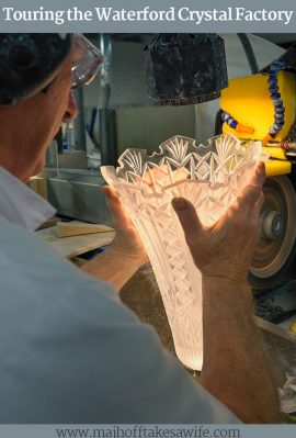 A master craftsman cutting glass on a diamond blade at Waterford Crystal Factory
