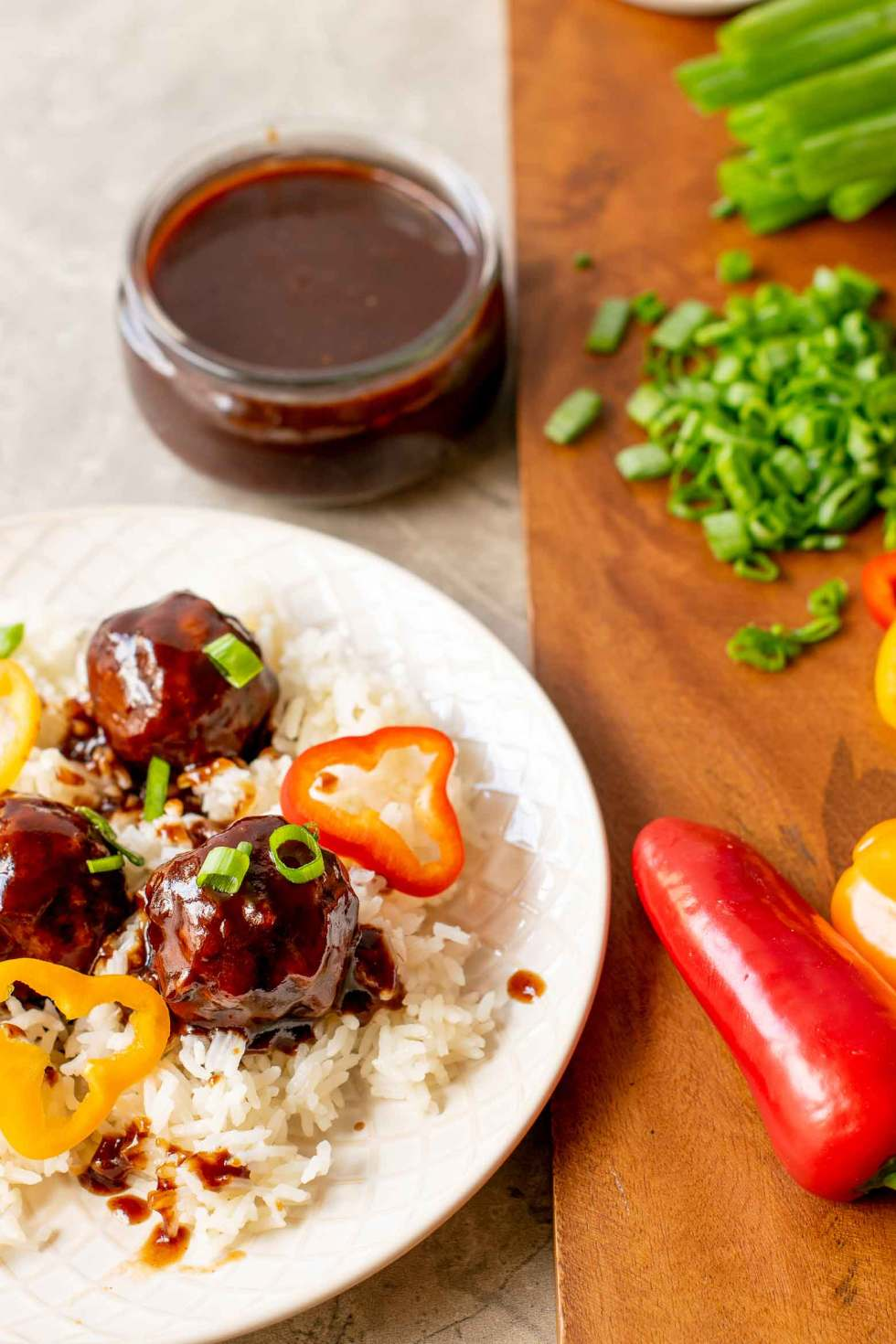 peppers and green onions on rice and spicy meatballs