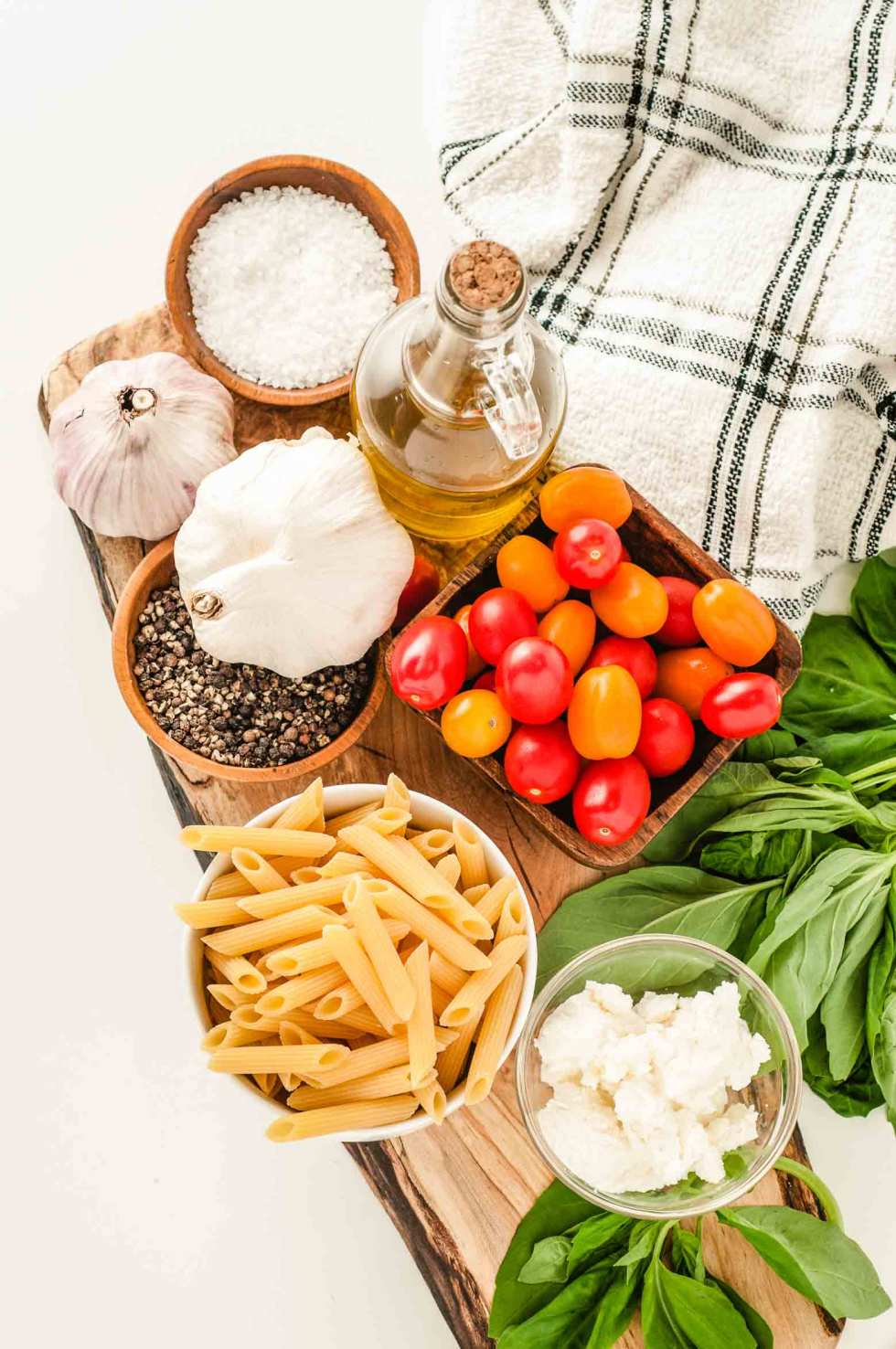 ingredients needed for a basic tomato basil sauce include garlic, salt, pepper, olive oil, noodles, tomatoes, basil and ricotta
