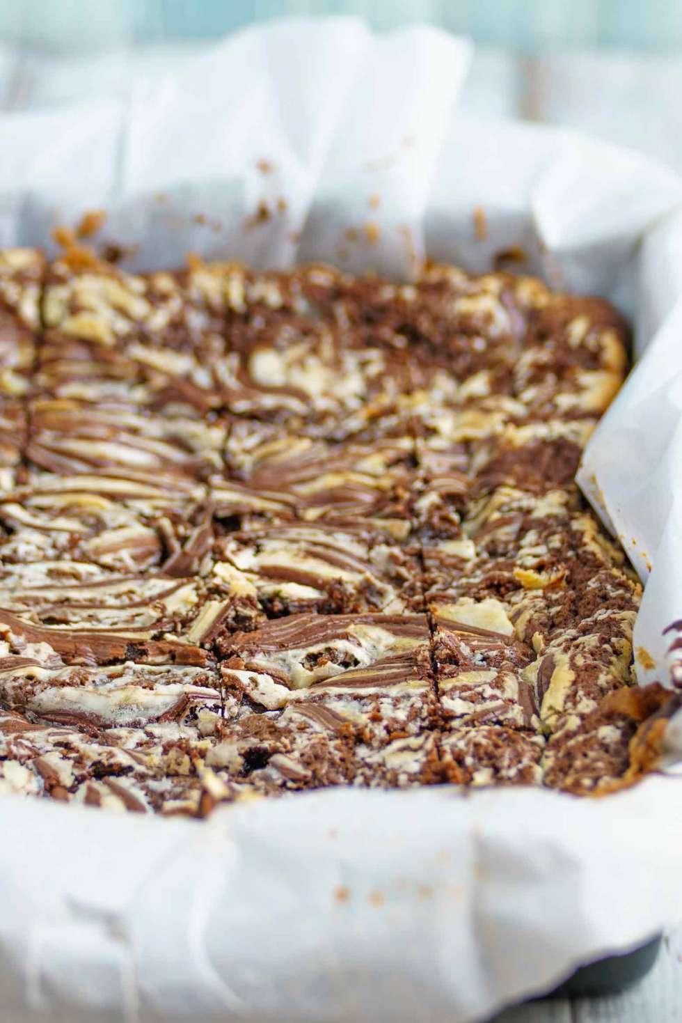 A pan of chocolate ginger cheesecake bars
