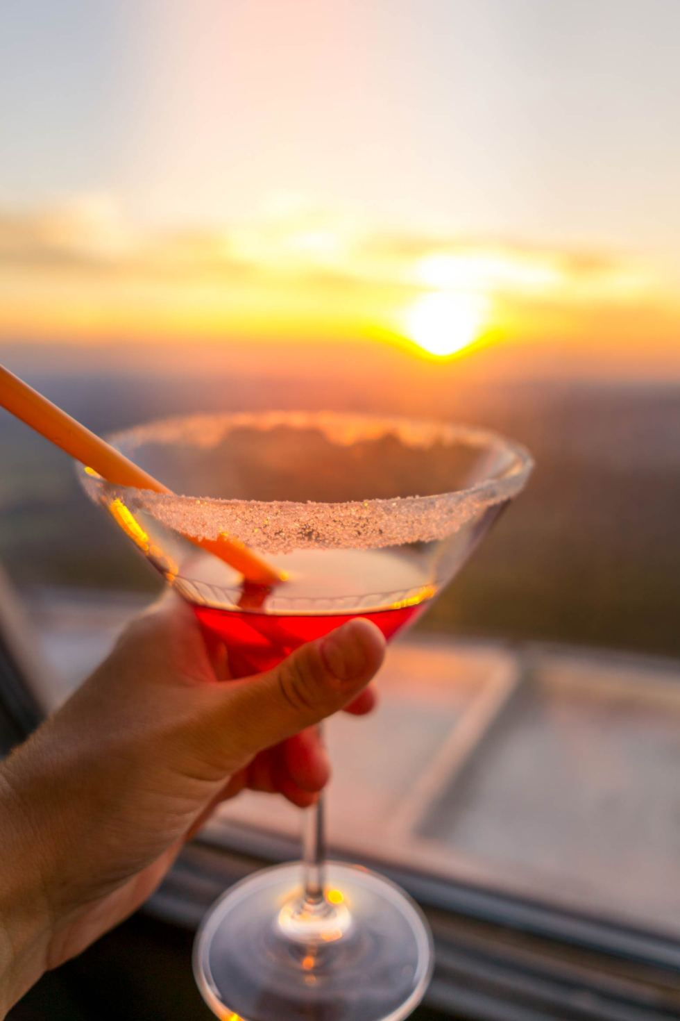 sunset view with a cocktail from the windows