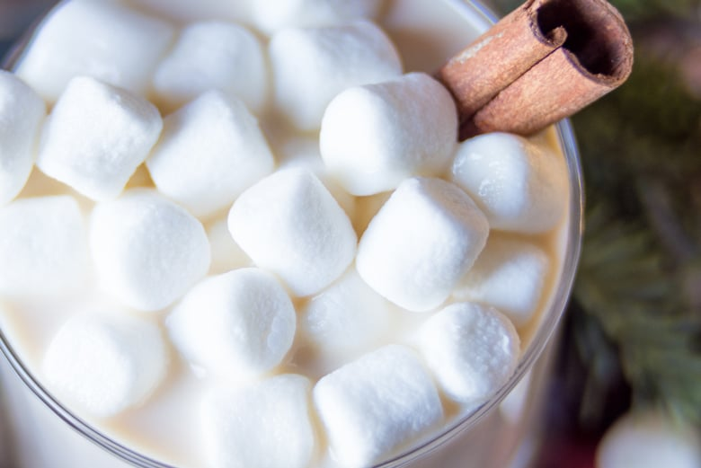 marshmallow and a cinnamon stick for creamy hot cocoa
