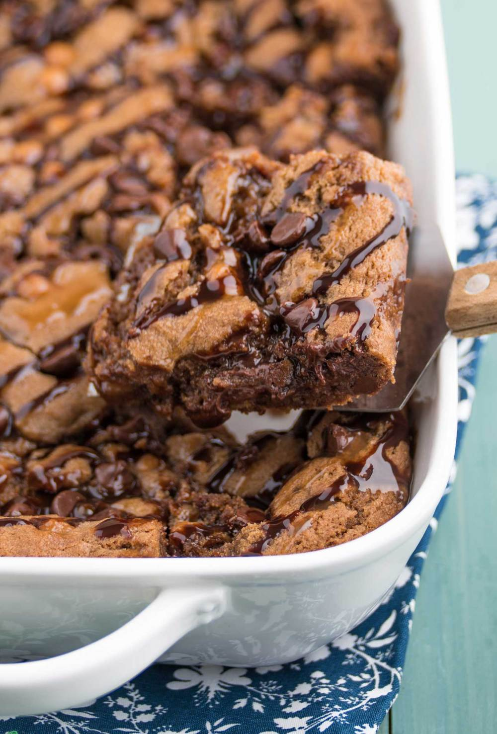 chocolate caramel cookie bar, soft and chewy brownie texture on a spatula