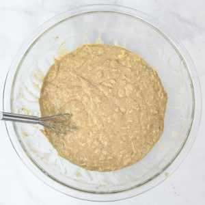 a wet batter after mixing in dry ingredients in a glass bowl