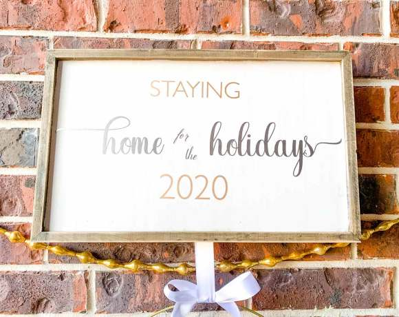 close up of Staying home for the holidays 2020 sign