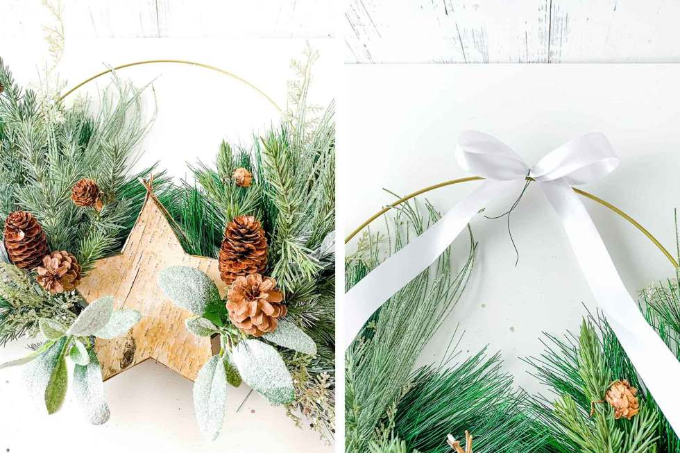 hot glueing a birch bark star and placing a ribbon on a wreath