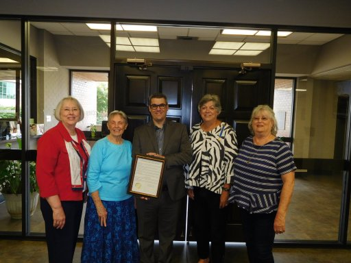Cabot Mayor Ken Kincade displays signed proclamation with chapter members