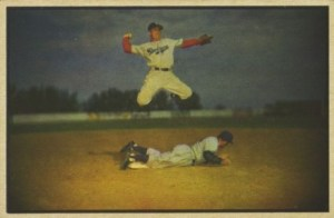 The first action photo baseball card in 1953 features Brooklyn HOFer Pee Wee Reese. Awesome!