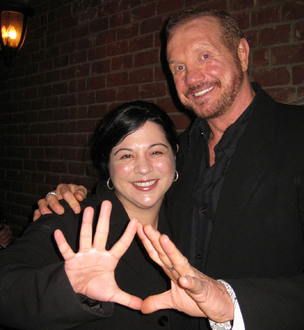 Actor and wrestler Diamond Dallas Page with guest attend the Grand Opening of Radical Publishing held at the Radical Publishing offices on February 19, 2009 in Los Angeles, California.