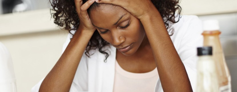 stressed black woman land fraud scam