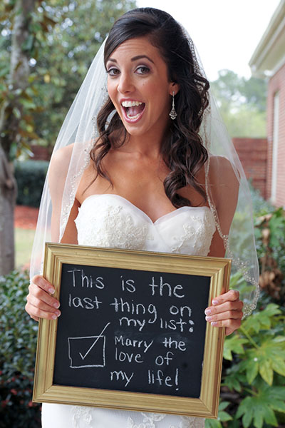 Bride holding chalkboard , wedding planning