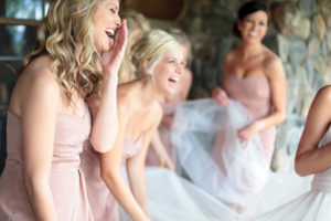 candid bridesmaids laughing