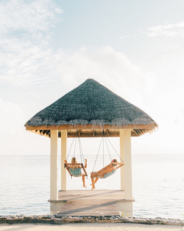 Couple hanging out on honeymoon in maldives