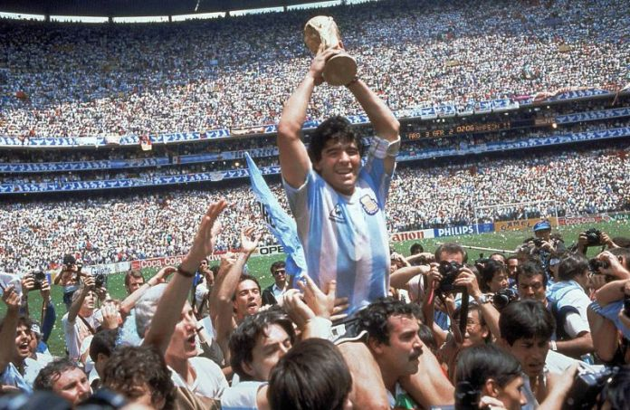 Diego Maradona of Argentina celebrates with the cup at the end of the World Cup soccer final in the Atzeca Stadium, in Mexico City, Mexico, on June 29, 1986. Argentina defeated West Germany 3-2 to take the trophy. (Ap Photo/Carlo Fumagalli)