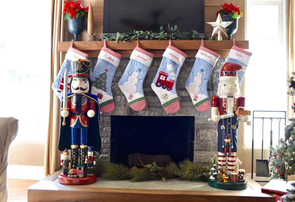 Christmas stockings on mantle in Christmas living room