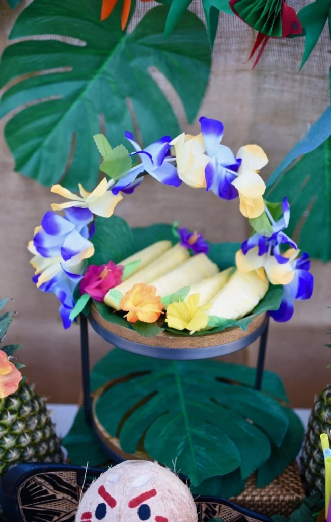 Cute Moana party table! Decorate with flower leis and big tropical leaves.