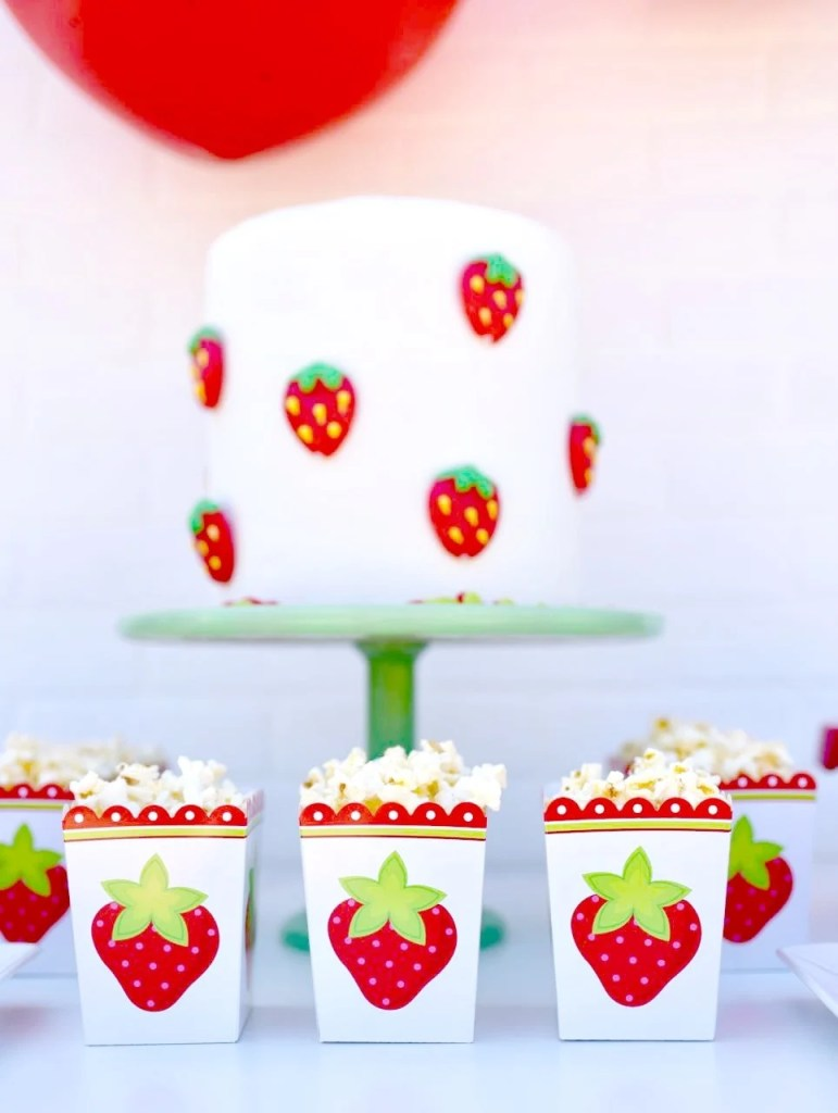 Strawberry party boxes with popcorn at strawberry party
