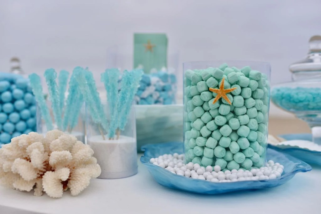 Beach themed green and blue candy buffet for wedding