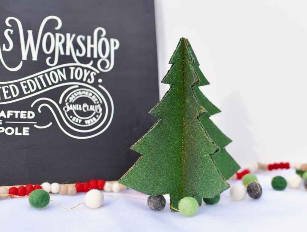 Cardboard Christmas tree craft. Perfect for the holidays and makes for a simple, yet fun Christmas craft.