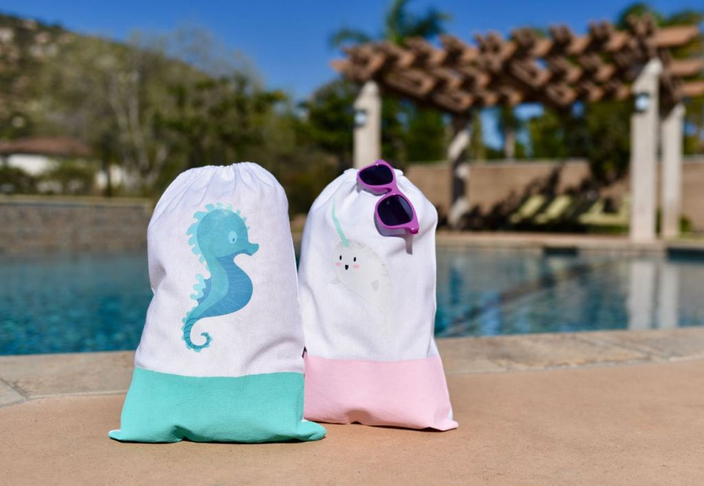 Simple beach bag DIY in less than 5 minutes. Make a darling beach bag for yourself or the kids this summer with Cricut Iron-On Designs- NO Cricut machine required!