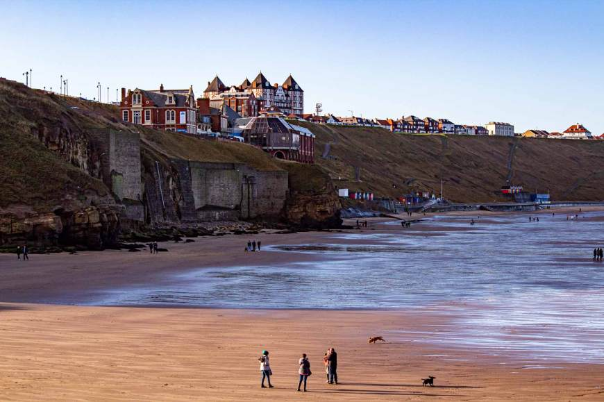 View of Whitby beach and Whitby Pavilion from the west pier