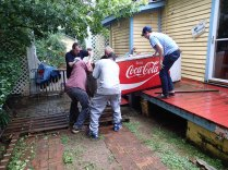 Moving the Coca Cola cooler off the porch.