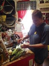 Day 5: Jeanne shucks corn.