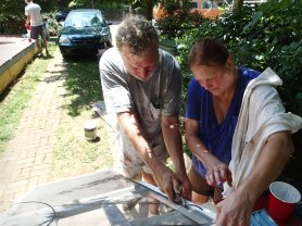 Day 1: Greg and Jeanne work on the screen door.