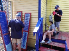 Day 3: Paul works on the shutters while Teresa and JoAnne work on the walls.