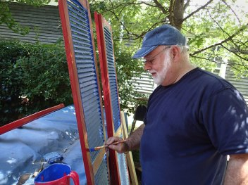 Day 3: Paul paints the shutters.