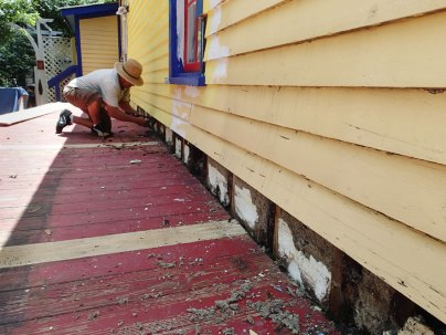 Day 2: Chavez works on replacing boards.