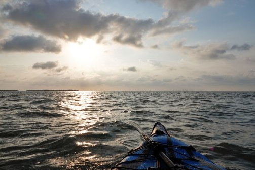 Kayaking out into the bay first thing in the morning.