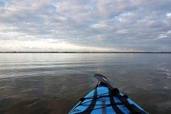 Kayaking across the open water.