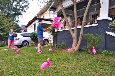 Wayne takes his turn with the piñata.