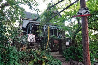 """The former home of David Thayer. David was eccentric, cantankerous, genuine, kindhearted, a Cabbagetown treasure, and sometimes """"grumpy."""" As a stonemason he created some of the most beautiful gardens, walls, and waterfalls in and around Atlanta. He died in February of last year and will be eternally missed."""