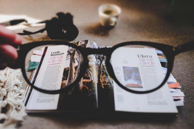 eye glass a cup books on table
