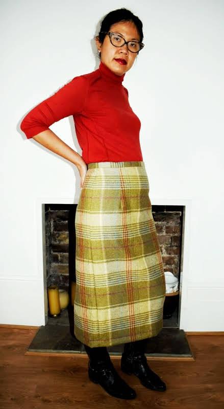 wearing a tweed skirt