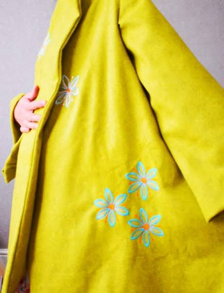 Embroidery design on a cape coat