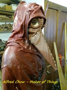 The leather clad Plague Doctor showing off his new beak mask.
