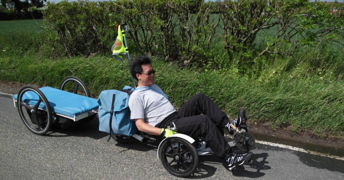 Me on my recumbent trike and towing a trailer